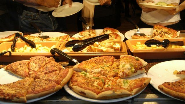 Pizzas at buffet stand