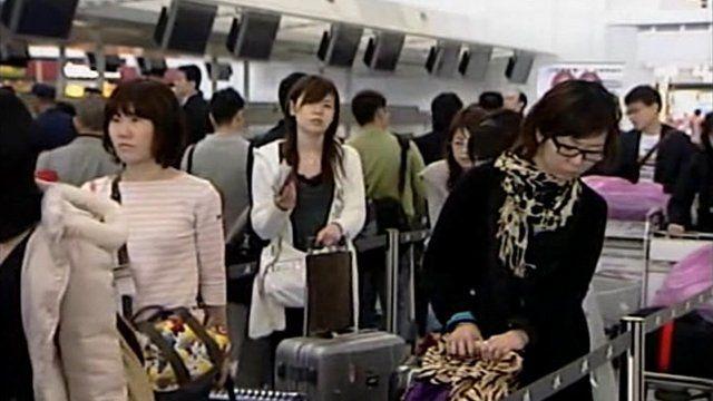 Passengers at Hong Kong airport
