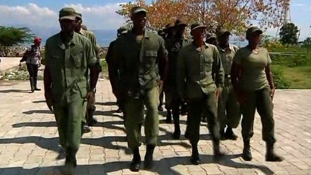 Former soldiers and new recruits marching in formation