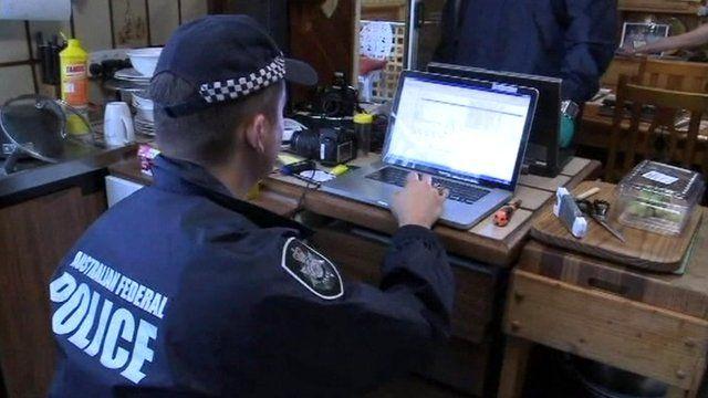 Police investigating computer equipment