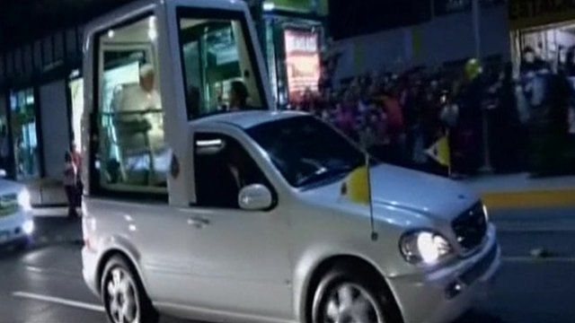 Pope sits in Popemobile in Mexico.