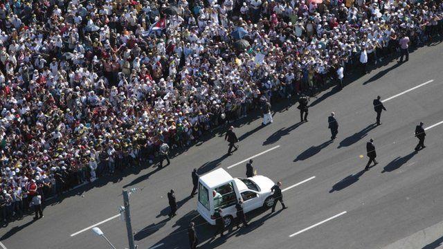 The popemobile arrives in Havan's Revolution Square