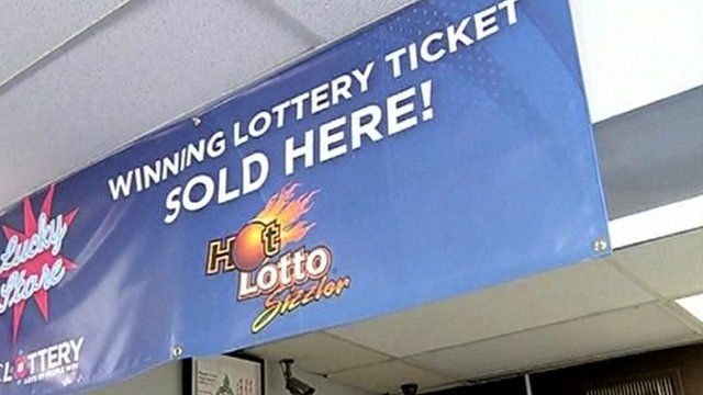 "Banner in shop which says ""winning lottery ticket sold here""."