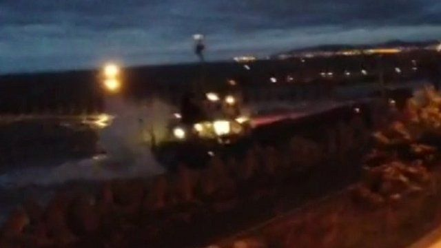 Two lifeboats and a helicopter were called at 20:30 BST after the ship hit a rock near a quarry jetty at Llanddulas