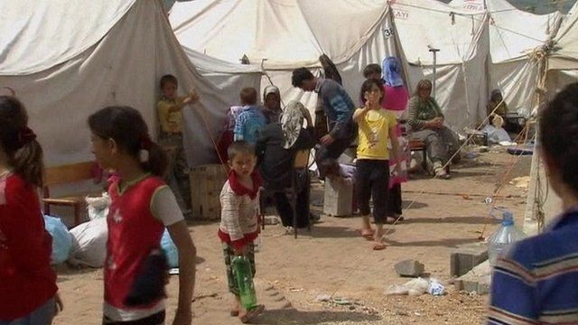 Refugees in a camp on the Turkey-Syria border