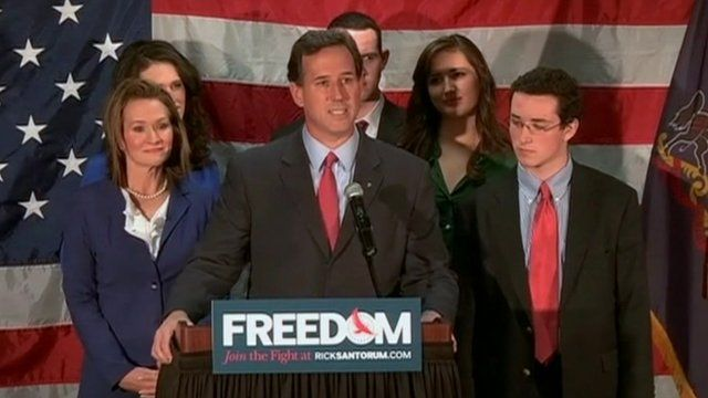 Rick Santorum, addressing supporters and flanked by his family, exits the Republican candidacy race.