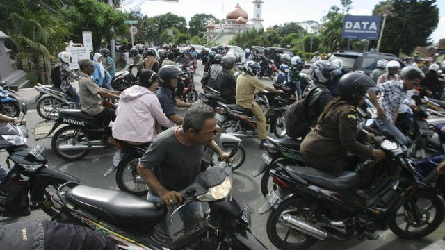 People on motorbikes in Banda Aceh
