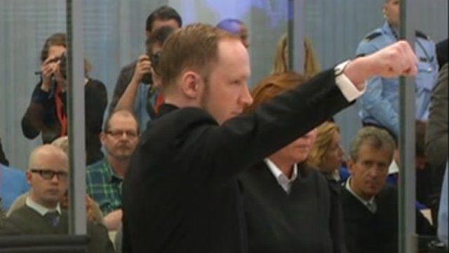 Anders Breivik makes a salute in court