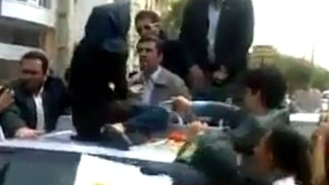 The woman talking to President Ahmadinejad