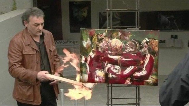 A painting by German artist, Astrid Stof, is set on fire in protest