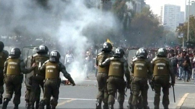 Police and student protestors in Chile