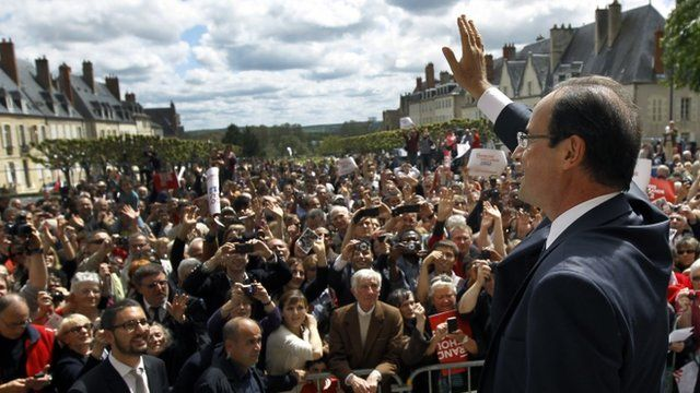 French Socialist Party candidate for the 2012 presidential elections Francois Hollande waves after delivering his speech during a meeting in Nevers