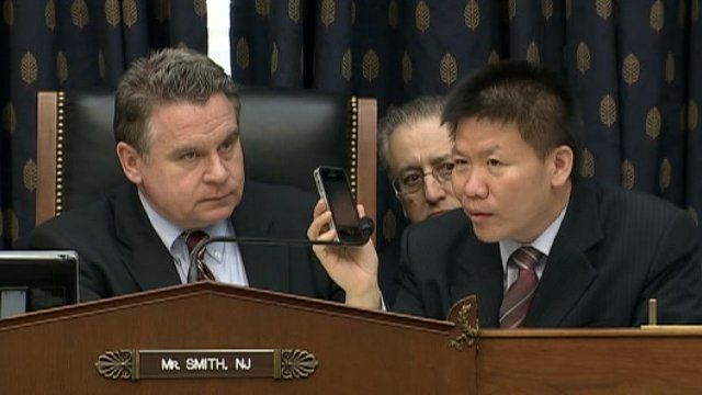 Chen Guangcheng speaks by phone to a Congressional hearing