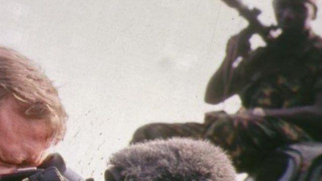 Cameraman filming a soldier in Sierra Leone