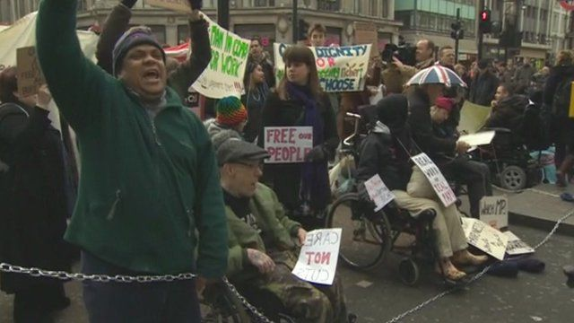 Protesters demonstrating against benefit changes