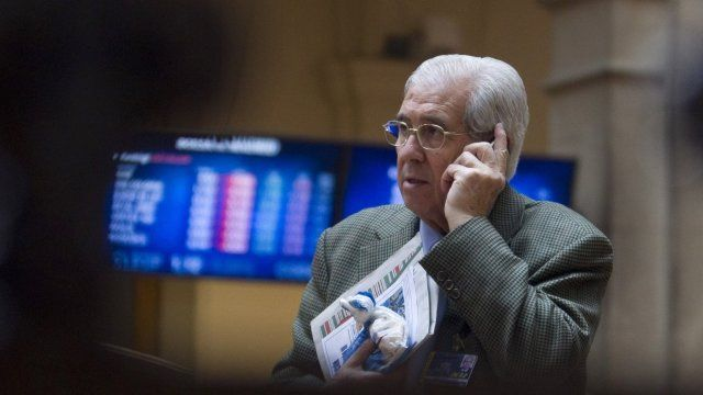 A broker at the stock exchange in Madrid