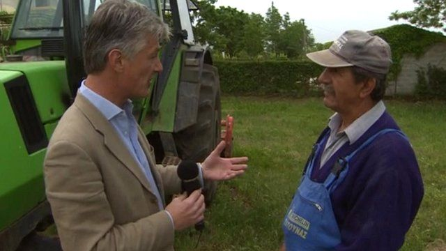 Tim Willcox speaks to a farmer in the Greek countryside