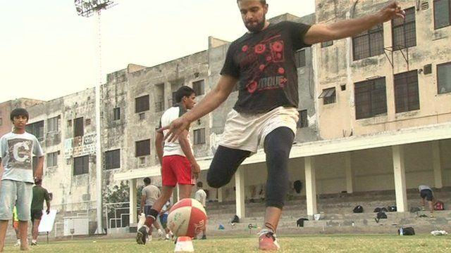 Pakistani rugby player kicking the ball
