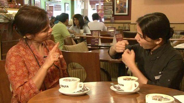 Ruma, who runs the Noida Deaf Society, and a waitress