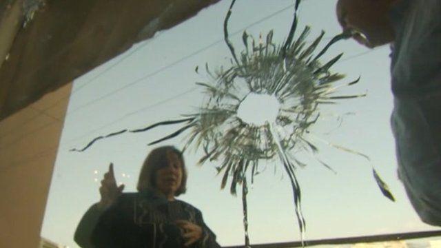 Bullet hole through glass