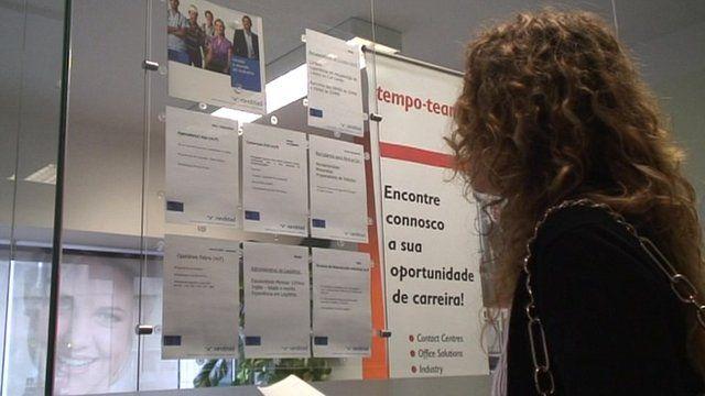 A woman looks at job vacancies