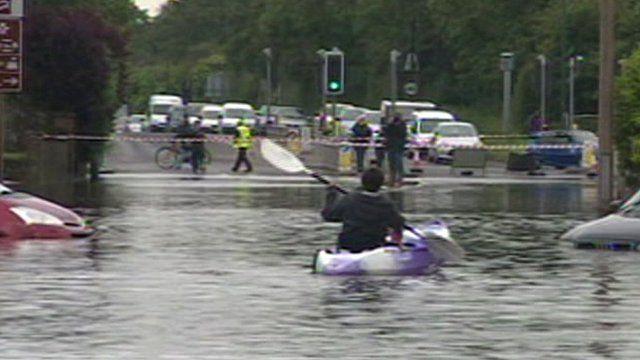 Canoe on a flooded road in Felpham