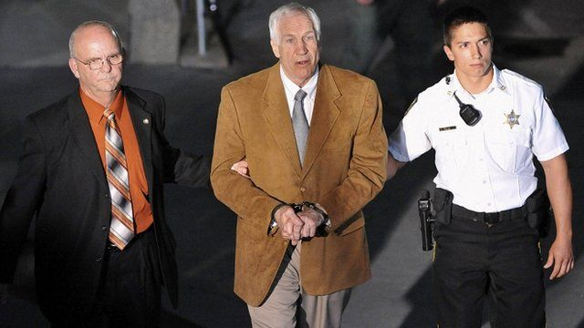 Jerry Sandusky leaves court in handcuffs