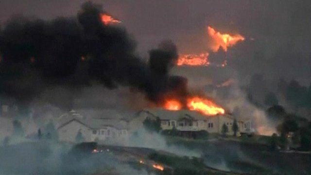 Fire threatens homes