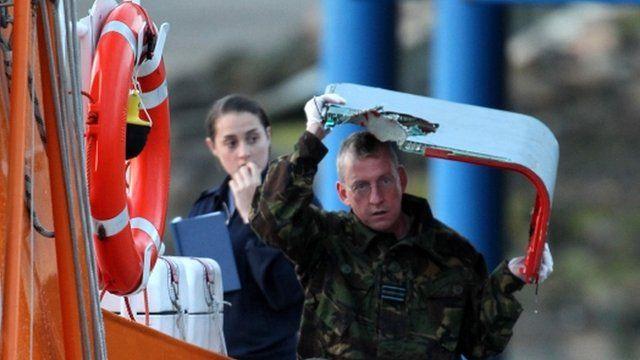 Plane wreckage is taken off Buckie lifeboat