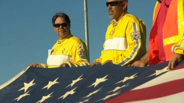 A flag is held up at a racecourse in Stockton, California