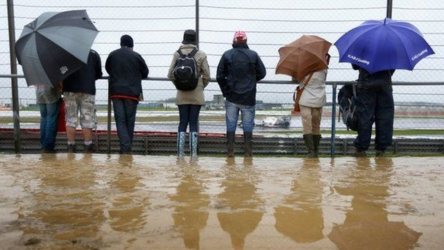 Fans watch in wet and muddy conditions during practice for the British Grand Prix at Silverstone