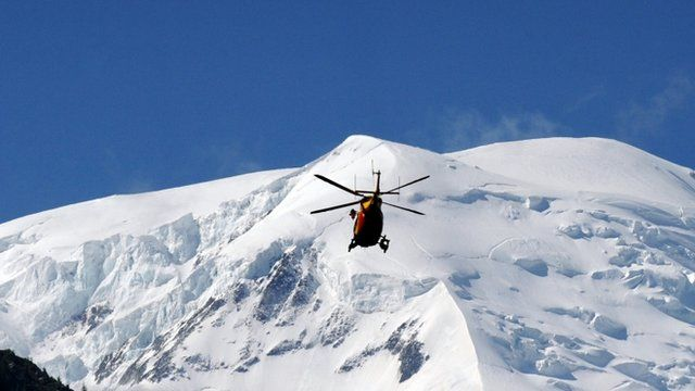 A rescue crew of the Securite Civile (emergency services) flies over the Mont Blanc