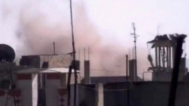 Smoke rises over buildings