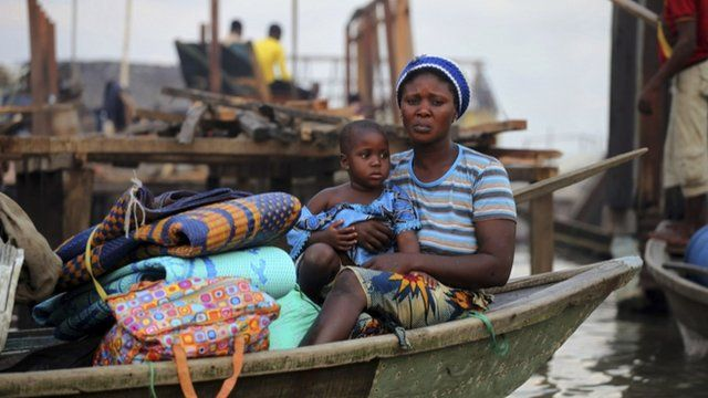 A woman sits in a canoe in Lagos