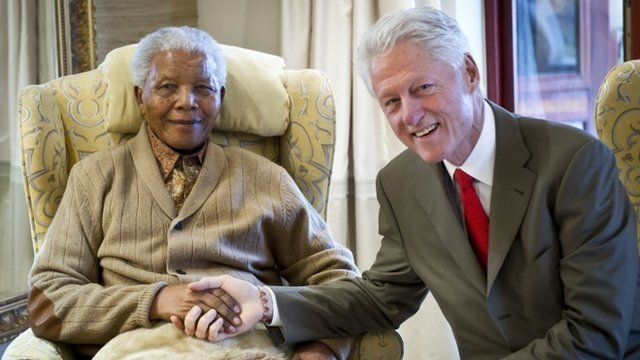 Former US President, Bill Clinton (R) pays a visit to former South African President Nelson Mandela
