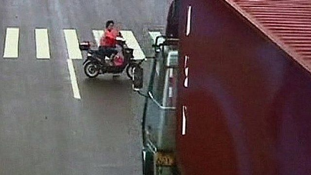 Woman on an electric bike about to be hit by a lorry