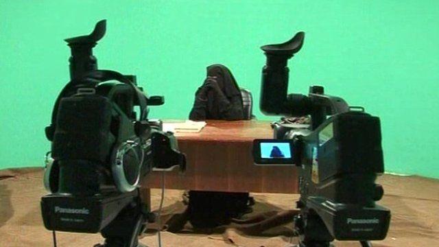 A presenter in a niqab