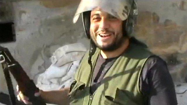 Rebel celebrates taking Aleppo police station
