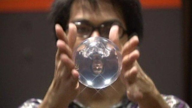 Man juggling an acrylic ball in the Philippines