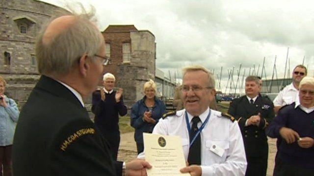 Peter Dymond presents a certificate to Calshot Tower volunteer Colin Lewis