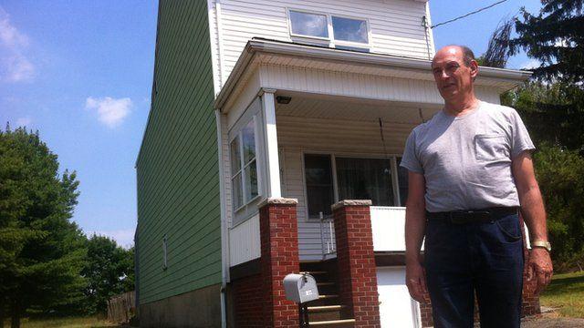 Harold Mervine outside his Centralia home
