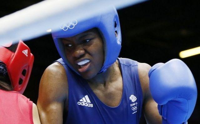 Historic gold for GB woman boxer Nicola Adams