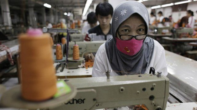 A worker makes clothes in a factory at Cakung, a small industrial settlement in Jakarta