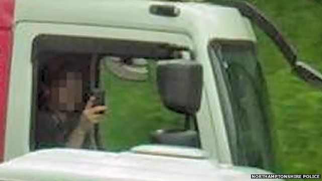 anonymous driver with his mobile phone