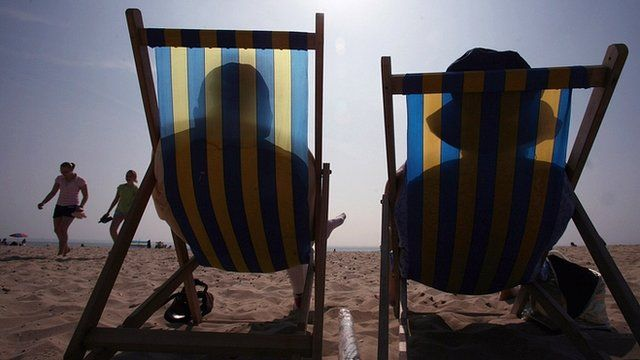Sunbathers in deck chairs