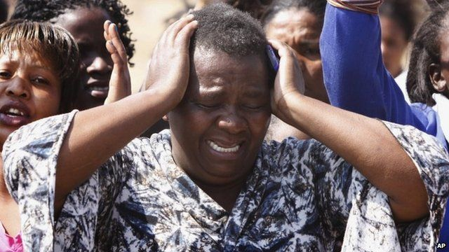 A woman cries as she protests against police near the Lonmin mine in South Africa. Photo: 17 August 2012