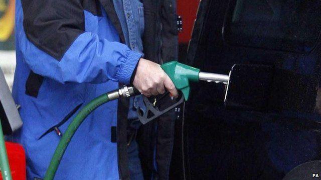 Man putting petrol in his car