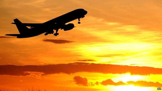 a plane leaving an airport