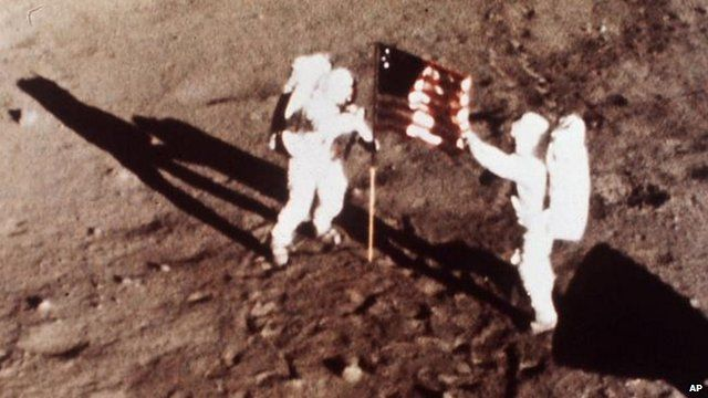 Neil Armstrong and Edwin Aldrin, plant the US flag on the lunar surface July 20 1969