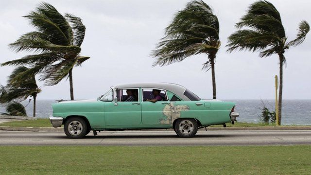 Strong winds blow palm trees in Havana in Cuba